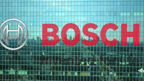 Aerial shot of office skyscraper with Robert Bosch GmbH logo. Modern office Live Action