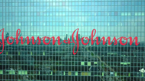 Aerial shot of office skyscraper with Johnson's logo. Modern office building Footage