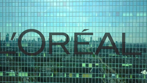 Aerial shot of office skyscraper with L'Oreal logo. Modern office building Live Action