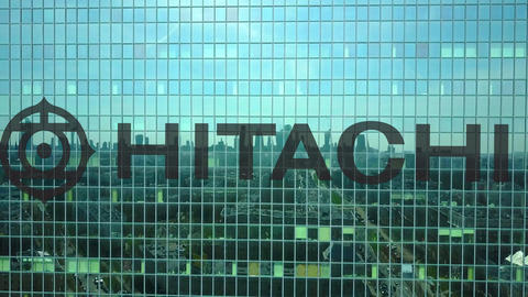 Aerial shot of office skyscraper with Hitachi logo. Modern office building Footage