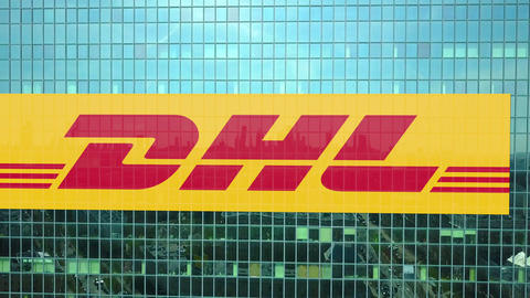 Aerial shot of office skyscraper with DHL Express logo. Modern office building Footage