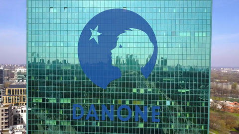 Aerial shot of office skyscraper with Danone logo. Modern office building Footage