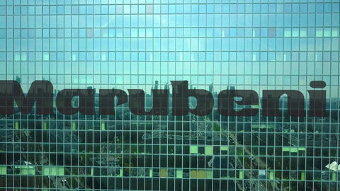 Aerial shot of office skyscraper with Marubeni Corporation logo. Modern office Footage