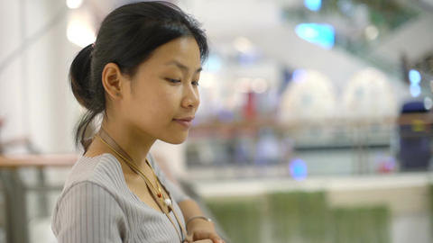 Portrait of Young Thai Lady in shopping mall shallow DOF Footage