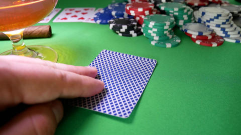 Winner In Poker Moves Chips on Table at Casino Live Action