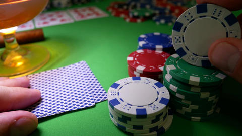 Gambling Player Moves Poker Chips on Table at Casino Footage