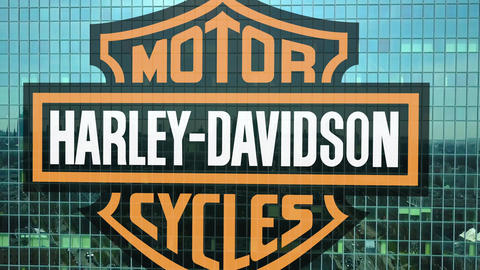 Aerial shot of office skyscraper with Harley-Davidson, Inc. logo. Modern office Live Action