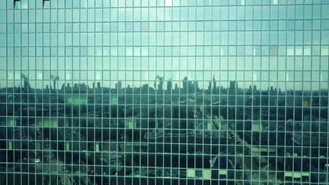 Modern office building windows reflecting cityscape Footage