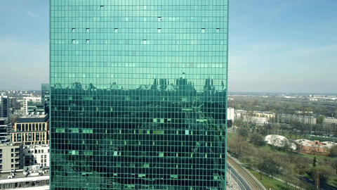 Aerial of an office building green tinted mirror facade Footage