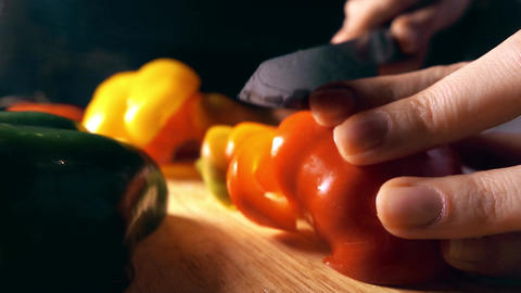 Amateur cook cutting juicy red sweet pepper Footage