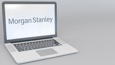 Opening and closing laptop with Morgan Stanley Inc. logo on the screen. Computer Footage