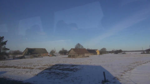 bus shadow in motion on snowy field near road Live Action
