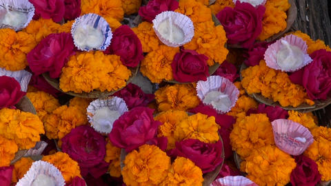 hindu sacred puja ritual flowers in Varanasi city on old table, India Live Action