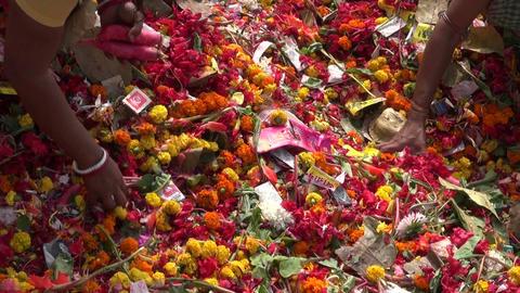 ritual flowers and prayers hands near Dakshineswar Kali temple, December 25, Live Action