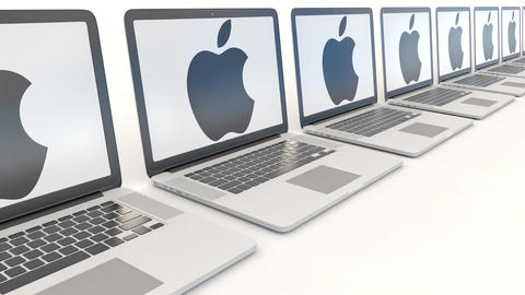 Modern laptops with Apple Inc. logo. Modern office building entrance. Computer Footage