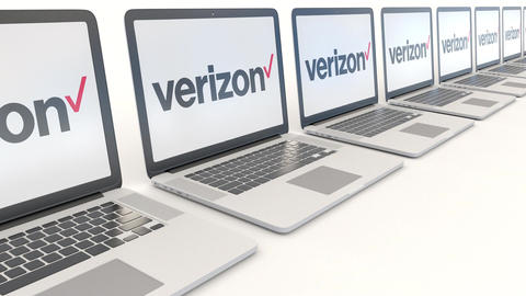Modern laptops with Verizon Communications logo. Computer technology conceptual Footage