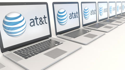 Modern laptops with American Telephone and Telegraph Company AT T logo. Computer Footage