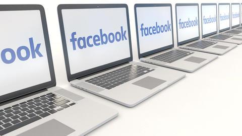 Modern laptops with Facebook logo. Computer technology conceptual editorial 4K Live Action