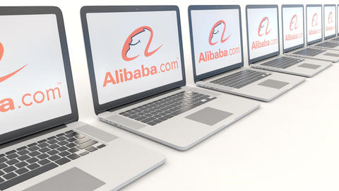 Modern laptops with Alibaba.com logo. Computer technology conceptual editorial Footage