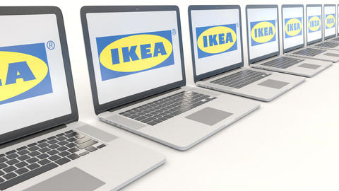 Modern laptops with Ikea logo. Computer technology conceptual editorial 4K clip Footage