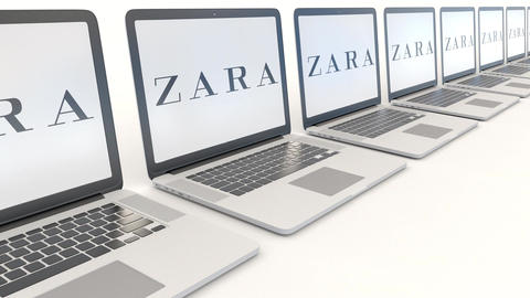 Modern laptops with Zara logo. Computer technology conceptual editorial 4K clip Footage