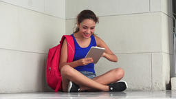 Happy Female College Student Using Tablet Live Action
