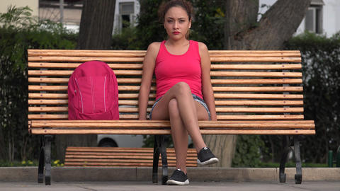 Female College Student Sitting On Park Bench Live Action