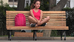 Happy Female Student Sitting On Park Bench Footage
