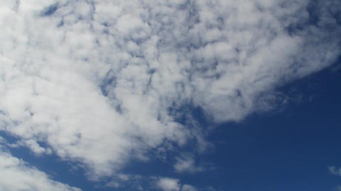 Time lapse clip of white fluffy clouds over blue sky ภาพวิดีโอ