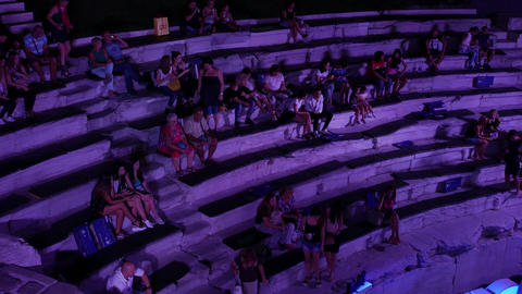 Audience at a concert in ancient roman stadium Live Action
