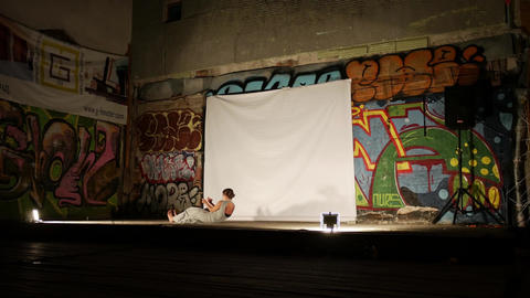 Woman performing on art stage with graffiti Live Action