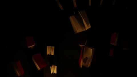 Books hanging from the ceiling - art installation Live Action