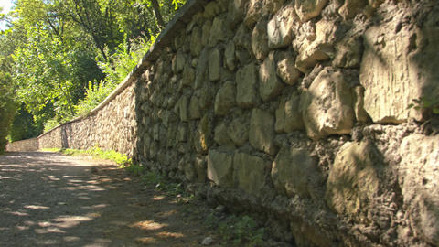 A stone wall along the old road Footage