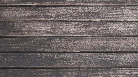 Zoom out closeup on tileable dark wood texture Stock Video Footage