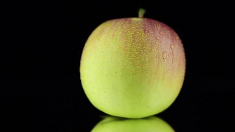 Apple with water drops Stock Video Footage