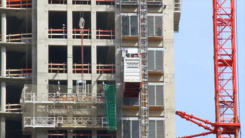 Construction elevator moves up Stock Video Footage