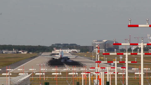 Plane lands on runway at Frankfurt airport Germany Stock Video Footage