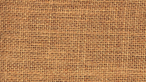 Zoom out closeup on sackcloth material Footage