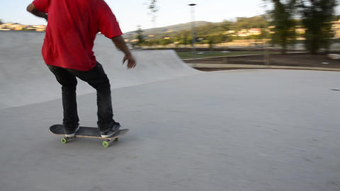 Skateboarder performing a manual Stock Video Footage
