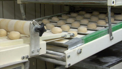 10736 roll bun on conveyor belt dolly wide quick Stock Video Footage