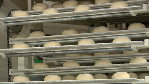 10739 german bakery roll bun on conveyor belt elevator Stock Video Footage