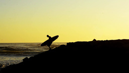 Surfer at sunset Footage