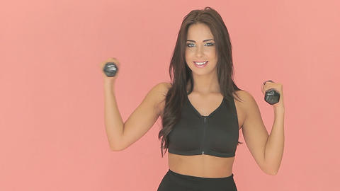 Fit woman exercising with dumbbells Stock Video Footage