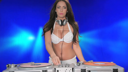 Sexy woman DJ working turntables Footage
