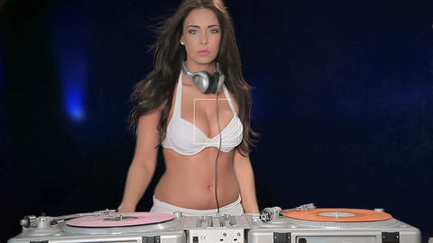 Sexy woman DJ working turntables Stock Video Footage