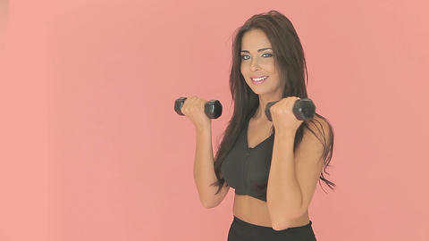 Beautiful woman working with dumbbells Stock Video Footage