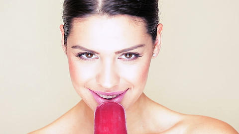 Woman with beautiful smile and ice lolly Stock Video Footage