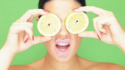 Woman with lemon eyes and puckered lips Stock Video Footage
