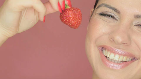 Beautiful sexy woman eating a strawberry Stock Video Footage