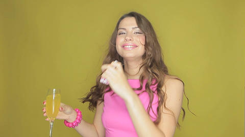 Happy woman partying with a drink in her hand Stock Video Footage